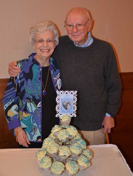 by: SUBMITTED - A picture from Mr. and Mrs. Stewarts' wedding day is part of the decoration for the cupcake tower to celebrate their 70th wedding anniversary.