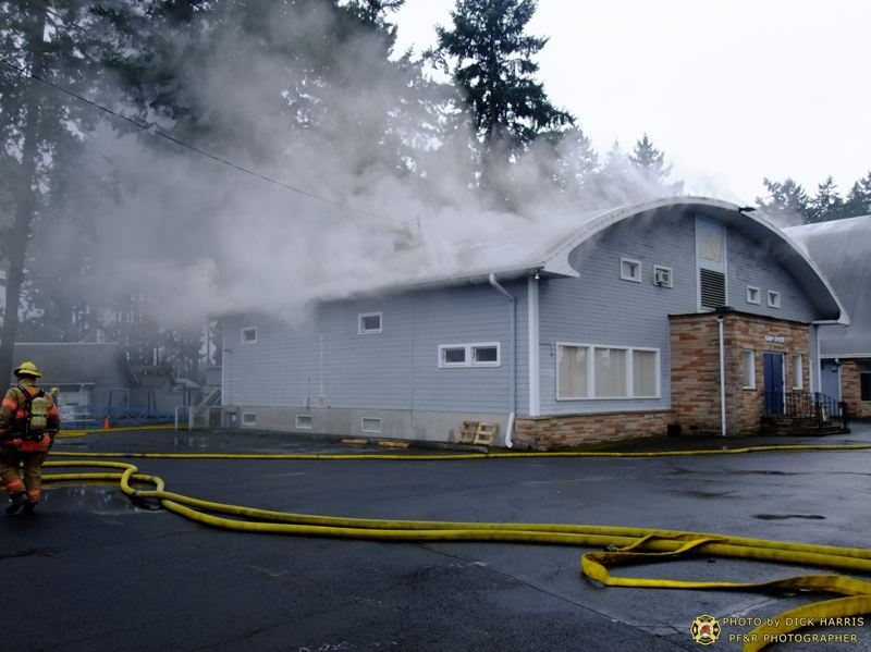by: PORTLAND FIRE & RESCUE/ DICK HARRIS AND GREG MUHR - The unique bow-shaped roof made fire fighting difficult at this church.