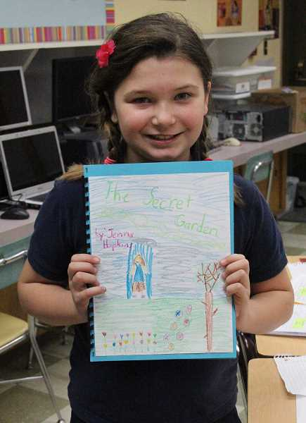 by: MAYGAN BECKERS - St. Luke Catholic School third-grader Jenna Hopkins shared 'The Secret Garden,' which is her final draft of teacher Laura Preuitt's assignment.