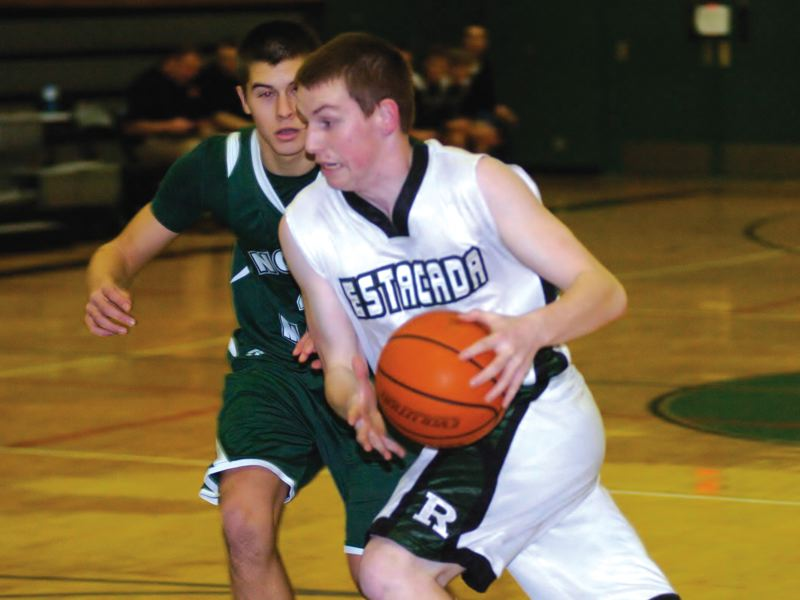 by: ESTACADA NEWS: PARKER LEE - Estacada guard Willie Blankenship drives past a defender during last weeks home loss to North Marion.