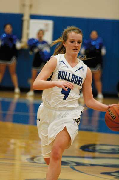 by: PHIL HAWKINS - Woodburn junior Lizzy Ellingson scored a team-high 10 points in the Bulldogs 66-32 loss to Lebanon Friday.