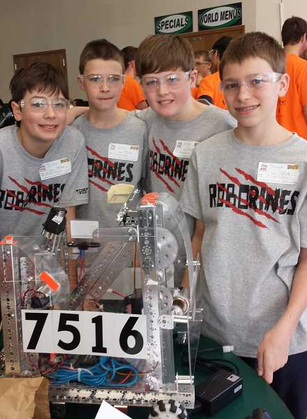 by: SUBMITTED PHOTO - From left to right, seventh-graders Tristan Cavarno, Dane Collins, Nathan Tidball and Trevor Johnson form the Roborines team.