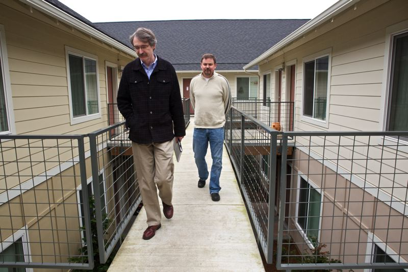 by: TRIBUNE PHOTO: JAIME VALDEZ - Public funding of low-income housing makes building efficiently impossible, say John Murphy, president of Portland Habilitation Center Northwest, and low-income housing builder Rob Justus, here touring their Snowberry Apartments.