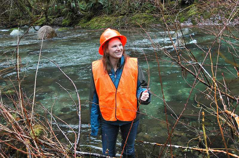 by: ISABEL GAUTSCHI - Morgan Parks of the Clackamas River Basin Council enjoys a visit to a restoration project.