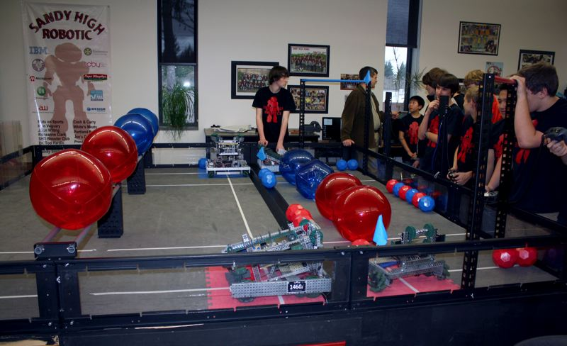 by: POST PHOTO: KYLIE WRAY - A match consists of two teams of two robots trying to maneuver their teams colored balls from one side of the arena to the other.
