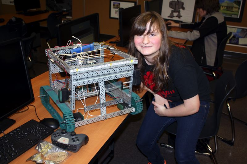 by: POST PHOTO: KYLIE WRAY - Freshman Ashton Burrell poses with her teams robot.