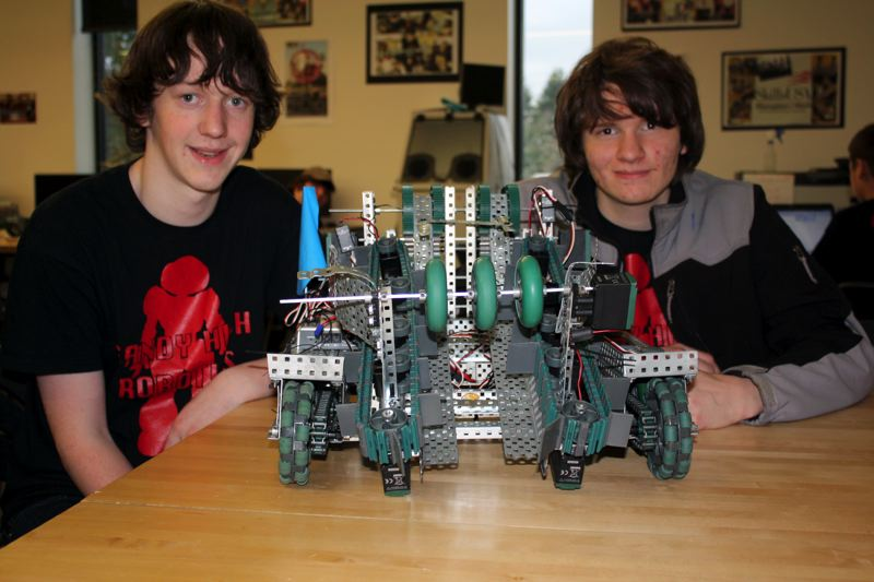 by: POST PHOTO: KYLIE WRAY - Sophomores Jakob Eslinger and Mason Colbry hope to make it to World Championships with their unique robot.