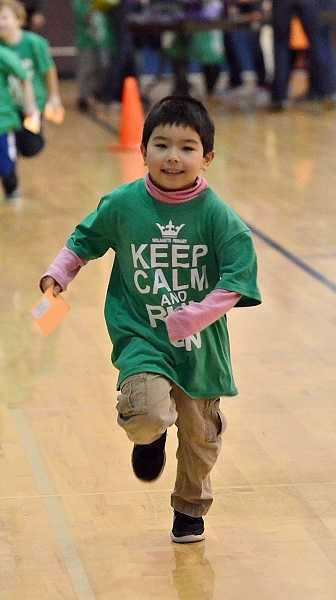 by: TIDINGS PHOTO: VERN UYETAKE - Kindergartener Noah Moorad keeps up a good pace as he adds to his lap total.