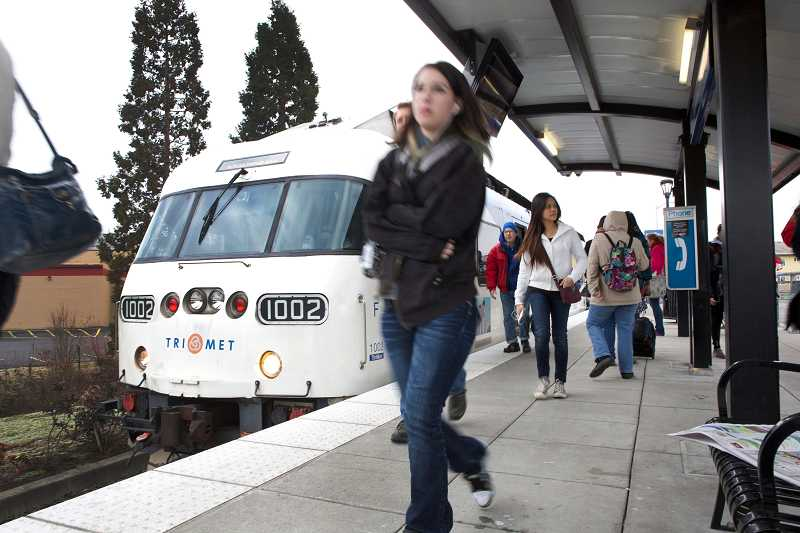 Passengers depart a TriMet WES train at the Beaverton Transit Center on Tuesday. The line serves more than 1,880 each day, but that's still below how many TriMet had predicted it would serve when it launched in 2009.