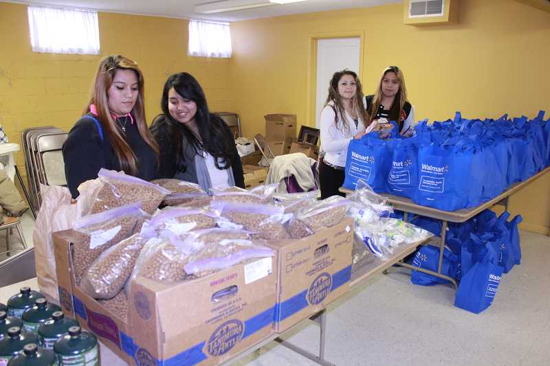 Volunteers Ada Garcia, left, Brenda Santellano, Fabiola Gonzales and Yaquelin Garcia get ready to pass out free propane fuel, dog food, hygiene kits, and bags of food at the homeless count event, which ran from 7 a.m. to 7 p.m.