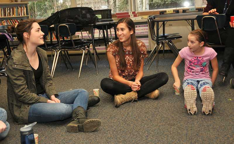 by: REVIEW PHOTO: VERN UYETAKE - Hannah Nicklos, senior, left, shares some of her hardest times of the year with Christina Miller, center, junior, and Grace Peterson, sixth grade.