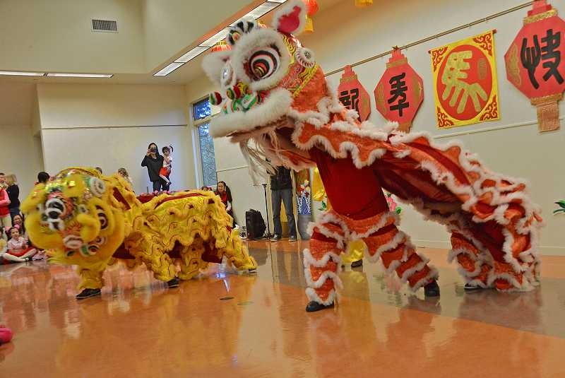 by: REVIEW PHOTO: VERN UYETAKE - International Lion Dance Team performed at a Chinese New Year event on Friday in Lake Oswego.
