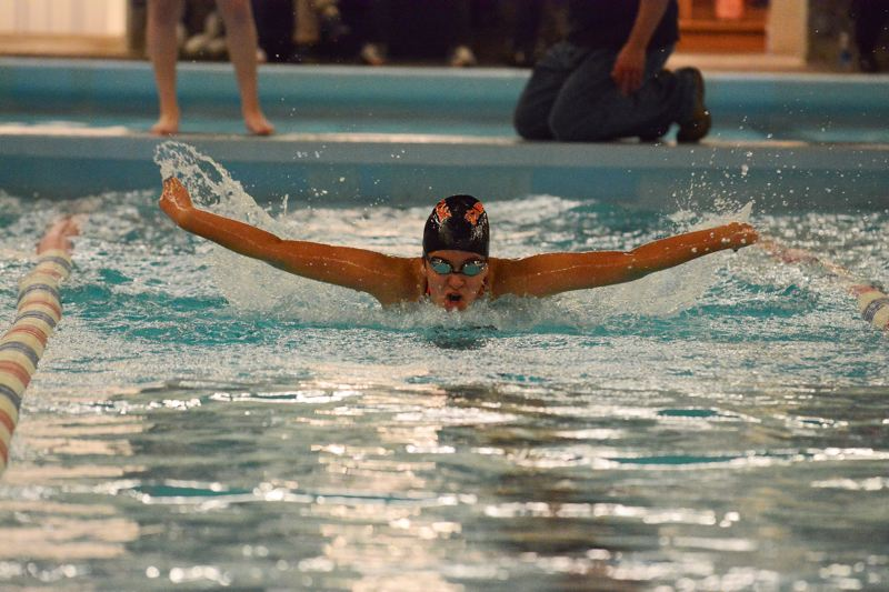 by: JOHN WILLIAM HOWARD - Scappoose junior Stefany Alvarez competes in the girls' 100 yard butterfly earlier this year. On Jan. 24, she went in for a heart procedure and was competing just six days later.