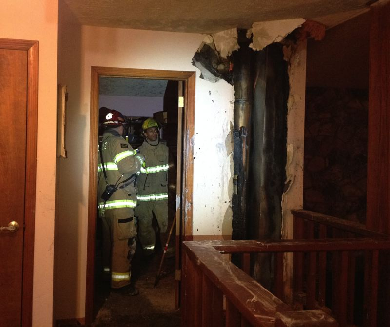 by: COURTESY PHOTO - A chimney fire damaged this Helvetia home Wednesday night.