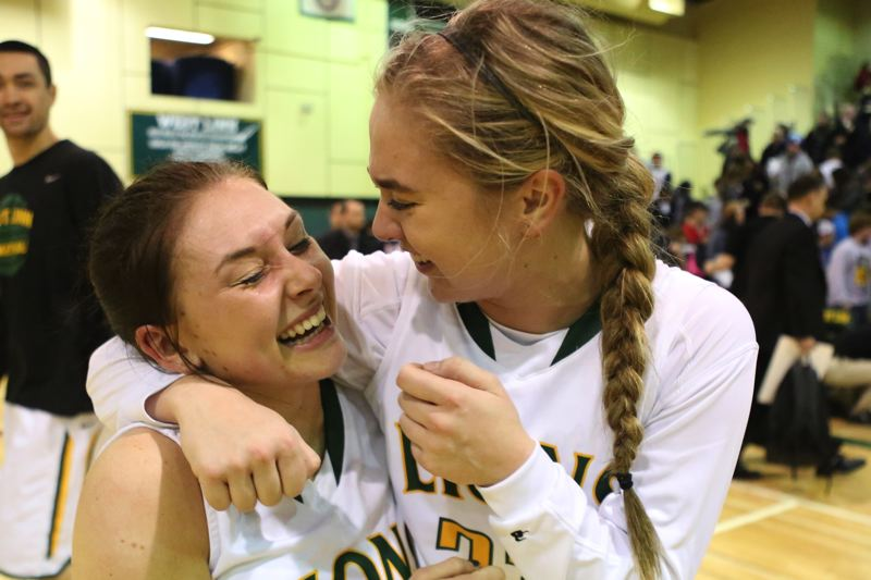 by: JAIME VALDEZ - West Linn's Courtney Landis, left, and Sidney Kolasinski celebrate after the Lions knocked off Oregon City at home Tuesday. The pair combined to drain six of West Linn's 12 3-pointers in the game.