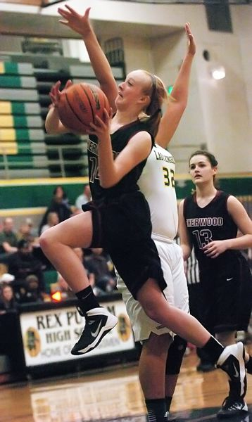 by: DAN BROOD - ON THE DRIVE -- Sherwood junior guard Jennah Stobie drives strong to the basket in Tueday's game.