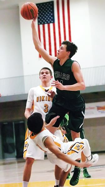 by: DAN BROOD - SOFT TOUCH -- Tigard senior guard Bryan Berg puts up a one-handed jumper during the Tigers' win at Forest Grove on Friday.