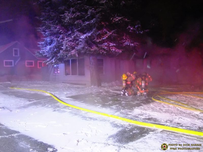 by: DICK HARRIS, PORTLAND FIRE & RESCUE - Cold weather did not prevent firefighters from extringuishing the blaze in this vacant house.