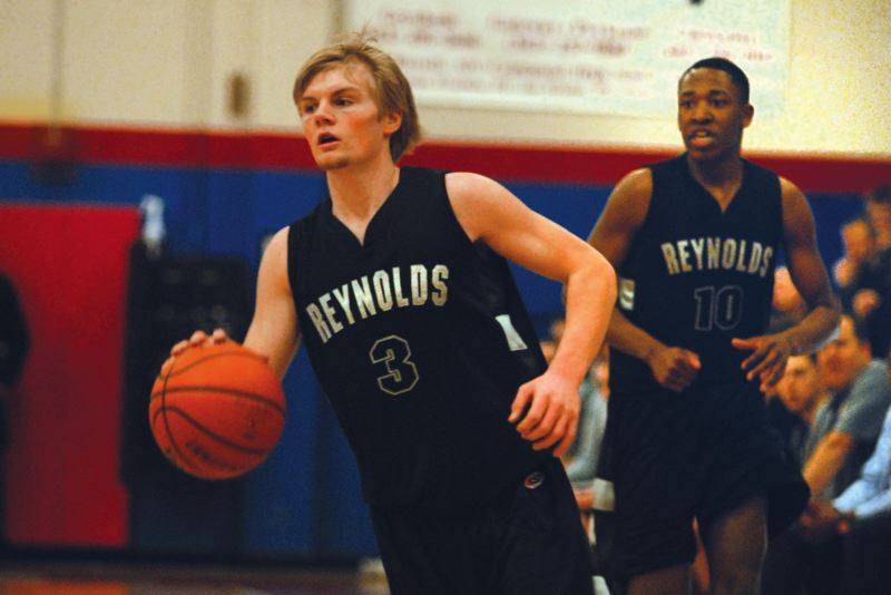 by: THE OUTLOOK: DAVID BALL - Reynolds guard Cody Starr heads downcourt on a fastbreak during Tuesdays win at Centennial.