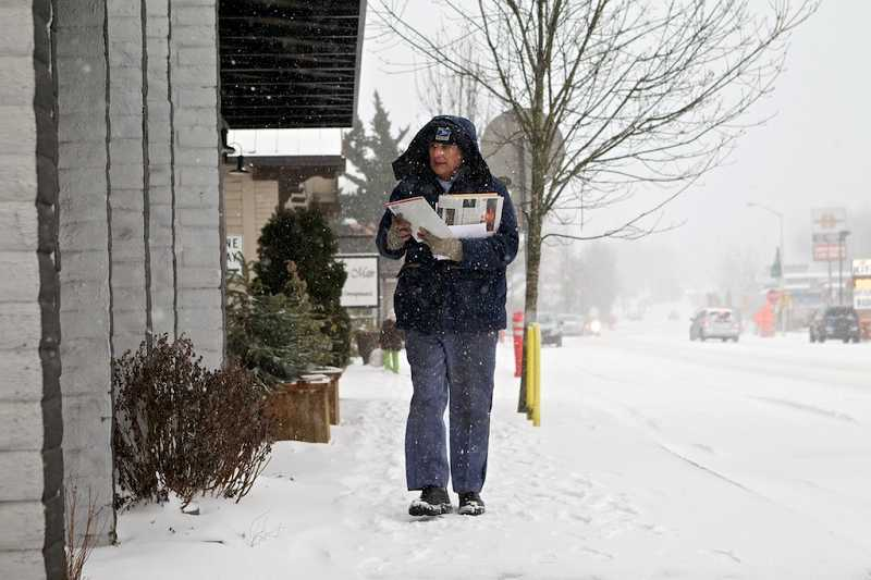 by: TIMES PHOTO: JAIME VALDEZ - Roger Brosseau delivers mail, and a few copies of the The Times, to businesses along Main Street on Thursday. Brosseau has been delivering mail for the U.S. Postal Service for 26 years.
