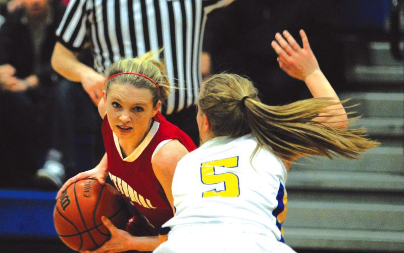 by: THE OUTLOOK: DAVID BALL - Centennials Brooke Bearman protects the ball from Barlows Caitlyn Pemberton during the Eagles 55-30 win Tuesday night.