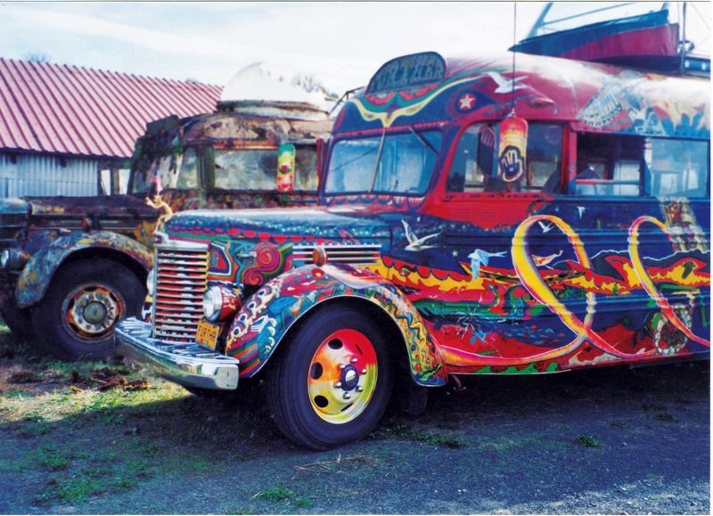by: PHOTO COURTESY OF GEORGE WALKER - Both of author Ken Kesey's 'Further' busses sitting next to each other. At front is a bus the author purchased in the 1980s to mimic the original. Kesey apparently tricked the media at the time into believing the original bus had been restored.