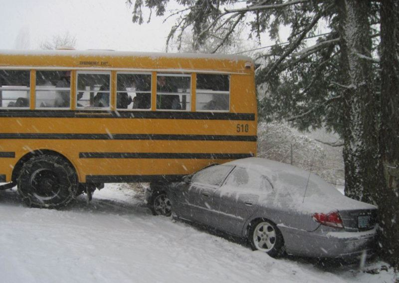 by: WASHINGTON COUNTY SHERIFF'S OFFICE - A Beaverton School District bus collided into a parked car at the intersection of Southwest 189th Avenue and Bany Road a little after 4 p.m. on Thursday as snow, cold temperatures and high winds made driving conditions treacherous during the evening commute.