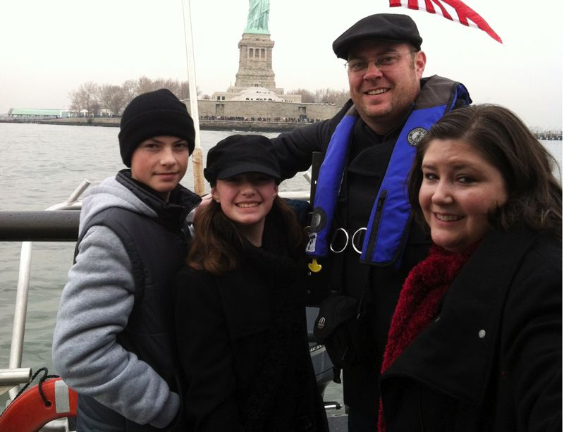by: COURTESY PHOTO - The White family of Banks, Joe, Emma, Dave and Jeanne visited the Statue of Liberty on a trip to New York in December, paid for by donations from Hillsboro businesses and employees of the Hillsboro Police Department, where Dave White is a sergeant. Joe, 14, recently underwent surgery to remove a burst vein in his brain, and Jeanne is fighting bone cancer.