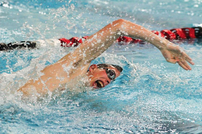 by: HILLSBORO TRIBUNE PHOTO: AMANDA MILES - Nathan Bennett anchors Glencoe's winning 400-yard freestyle relay team during Tuesday's conference dual meet against Forest Grove.