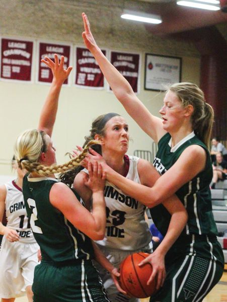 by: HLLSBORO TRIBUNE PHOTO: CHASE ALLGOOD - Glencoe freshman Abby Anderson gets trapped by a pair of Tigard defenders during Tuesday's Pacific Conference girls basketball game.