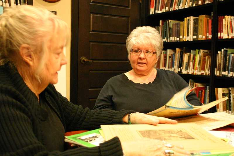 by: JASON CHANEY - Vicki Nelson (LEFT) and Mary Mayfield (RIGHT) work on a genealogy research project at Bowman Museum.