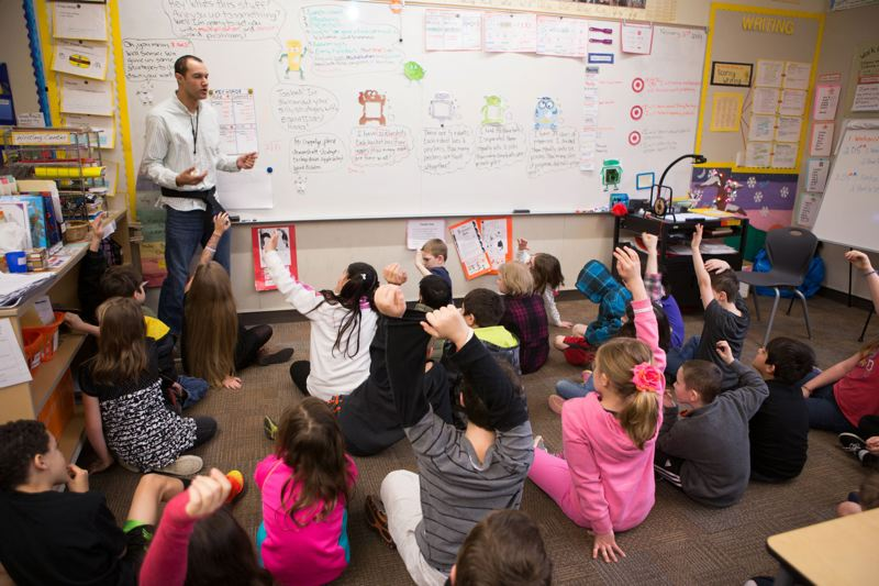 by: PHOTO BY: ALVARO FONTAN - Darryl Coppedge requires his third graders to solve a math-monster problem on the board before explaining the MathKwonDo process step by step to the rest of the Ardenwald Elementary School class.