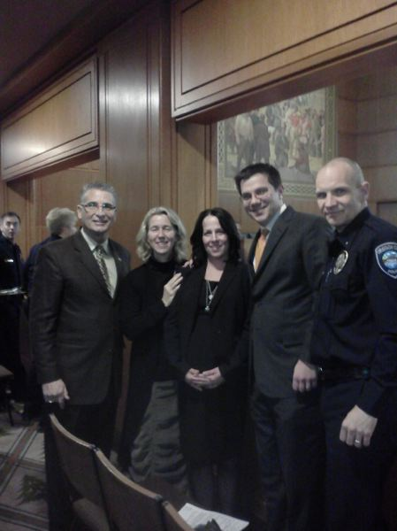 by: SUBMITTED PHOTO - Passing of 'The Officer Robert Libke Scholarship Act' is celebrated by his widow Wendy Libke (center), Oregon City Chief of Police Jim Band, along with sponsor State Reps. Bill Kennemer (from left), Alissa Keny-Guyer and Brent Barton.