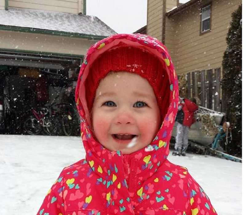 by: COURTESY OF SARAH CHAPMAN - Lillian Chapman expresses her joy at the freshly fallen snow that fell on Sherwood Feb. 6 through 8.