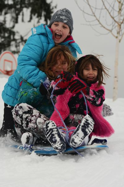 by: SPOTLIGHT PHOTO: JOHN WILLIAM HOWARD - Three Scappoose youngsters take advantage of the wintery blast to sled down a hill near Otto Petersen Elementary School on Friday, Feb. 7. South Columbia County was one of the most affected regions in the winter storm, with 8.5 inches of snow reported in Scappoose and 10 inches in St. Helens.