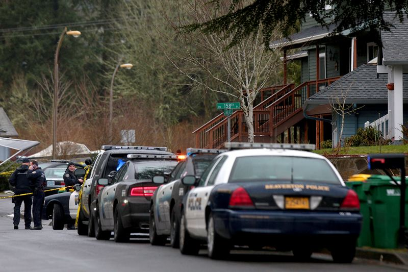 by: TIMES PHOTO: JONATHAN HOUSE - Beaverton police process a crime scene aftermath of an officer-involved shooting at a house on Southwest Bridle Hills Drive on Tuesday afternoon. A male suspect was hospitalized with serious injuries. No one else was shot or injured in what apparently began as a domestic disturbance.