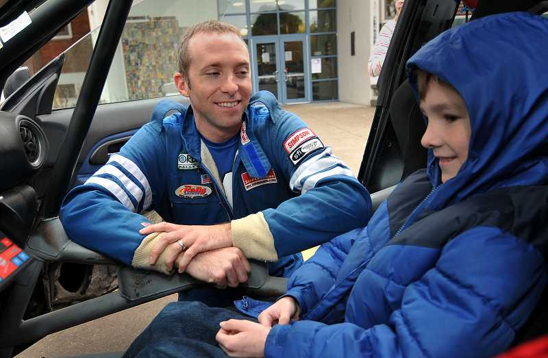 by: TIDINGS PHOTO: VERN UYETAKE - Mark Tabor and his son, Henry, have both come to love rally car racing and think of the events as family vacations.