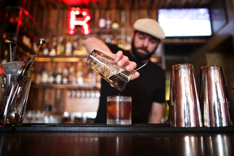 by: TRIBUNE PHOTO: JAIME VALDEZ - Nick Gusikoff, who is the owner of the Richmond Bar on Southeast Division Street, makes The Honey Suckle drink - made of bourbon, Drambuie, lemon and rooftop honey syrup.