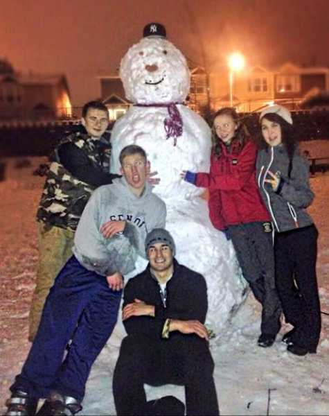 From left, Will Ash, Noah Walker, Isaac Shrier, Haley Beck and Rosiee Barigan put the finishing touches on their eight-foot snowman.