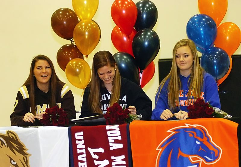 by: DAN BROOD - ON THE DOTTED LINE -- Tualatin High School seniors (from left) Megan Landmark, Jill Farley and Madison Campbell signed their national letters of intent last week at the school.