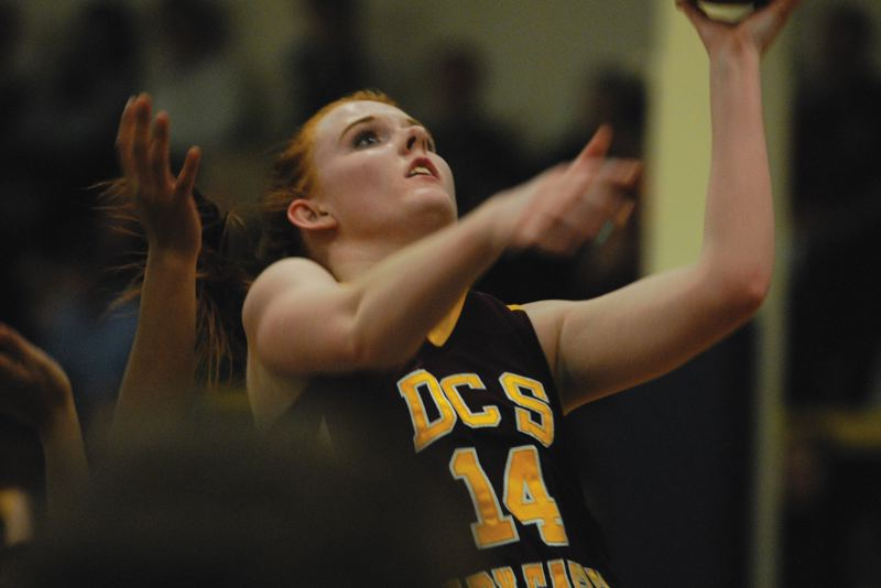 by: THE OUTLOOK: DAVID BALL - Damascus Christians Karissa Cox floats toward the basket to finish a fastbreak during the Eagles 60-30 win at City Christian on Tuesday.