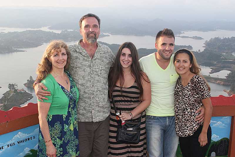 by: SUBMITTED PHOTO - The author, Holly Gill, poses with her family, husband, Bob, daughter Kelsey, son, Carter, and new daughter-in-law Andrea, on the viewing platform at the top of La Piedra del Penol in Guatape, Colombia.