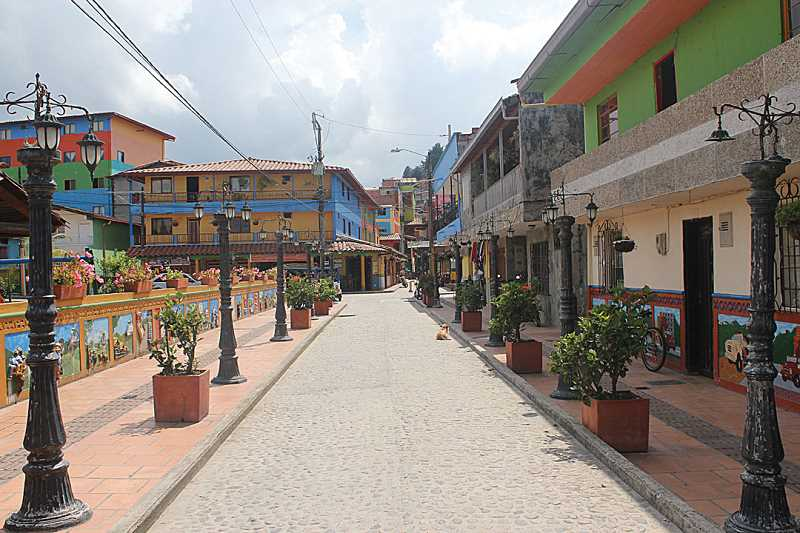 by: HOLLY M. GILL - The town of Guatape, Colombia, has narrow streets lined with shops.