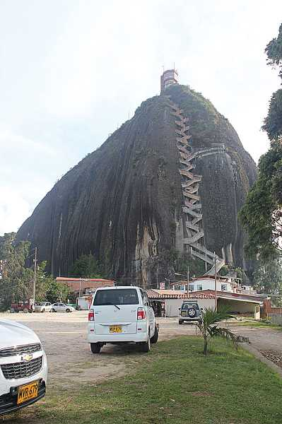 by: HOLLY M. GILL - La Piedra del Penol, a massive stone formation in the town of Guatape, about 53 miles northeast of Medellin, Colombia, is just over 7,000 feet at the top. The national monument has 659 steps to the top of the granite stone, and another 61 up a viewing tower on top of the rock.