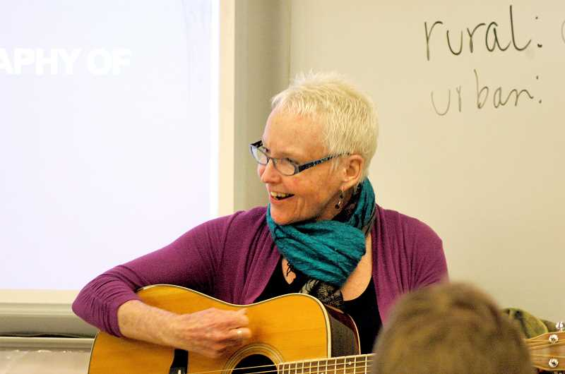 by: ISABEL GAUTSCHI - Ellen Whyte performs for Sean Tripp's eighth-grade social studies class.