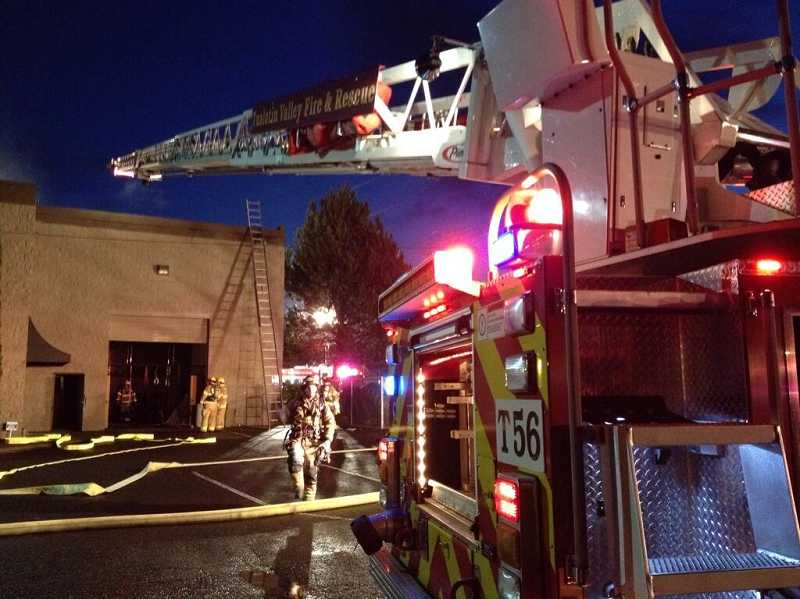 Fire crews battled a two-alarm fire in Tigard dental lab, Thursday morning.