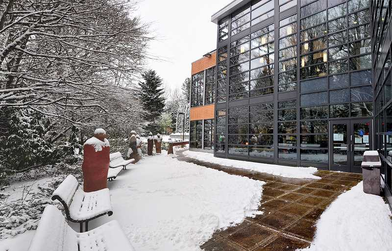 by: SUBMITTED PHOTO: CHERYL HILL - The librarians at West Linn Public Library dutifully braved the elements and opened its doors Friday, despite the wintery weather.