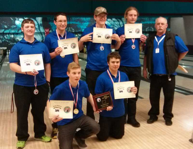 by: PHOTO COURTESY OF OCTAVA BEST-BECK - Members of the Crook County High School bowling club boys team pose with the trophy they earned for finishing second at the District 6 bowling championships, held in Klamath Falls. The second-place finish earns the team the right to compete in the state championships, which will be held in Medford  Feb. 22-23. Team members include Kolin Bicart, Austin Stilwell, Danny Turner, Joe Whitlach, Andre MccNary, and David (Ritchie) Stanley. Also in the photograph is coach Charles Beck. Not pictured is coach Octava Best-Beck.