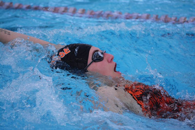 by: JOHN WILLIAM HOWARD - Mary Rotter swims the backstroke during the Indians' home meet on Jan. 21. Scappoose will compete in the Cowapa League championships in Astoria on Feb. 14 and 15.