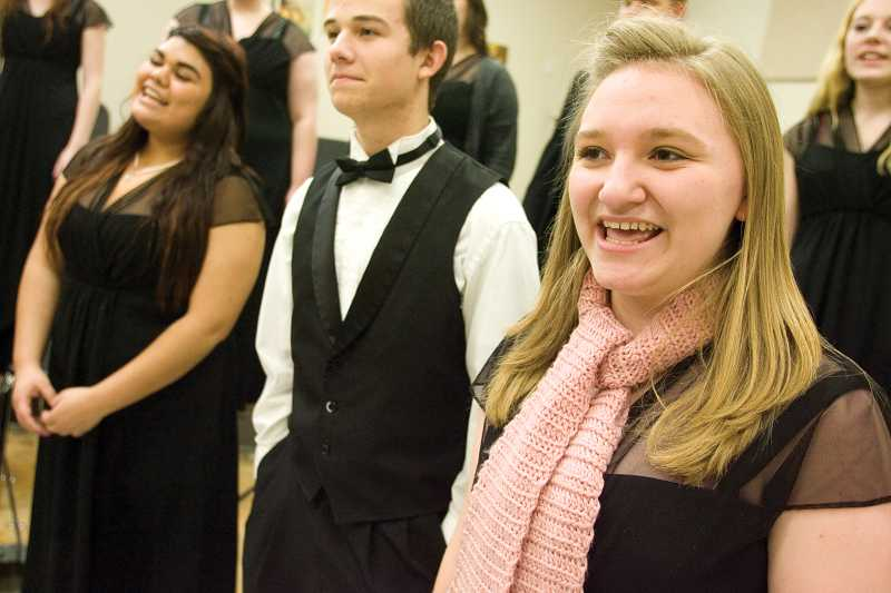 by: KEVIN SPERL - Sadee Moss, right, Josh Wieckert, and Teresa Maldonado rehearse with the Crook County High School Jazz Choir.
